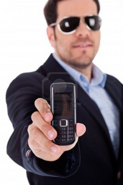 'Spring into TEGRA' Contest: Win a Tegra-powered HTC One X+!-6095644-business-man-wearing-sunglasses-showing-nokia-mobile-white-background.jpg