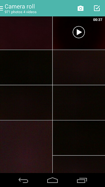 What on earth has happened to the photos in my gallery? Very odd.  -  Moto X (1st Gen)-screenshot_2015-02-03-21-25-34.png