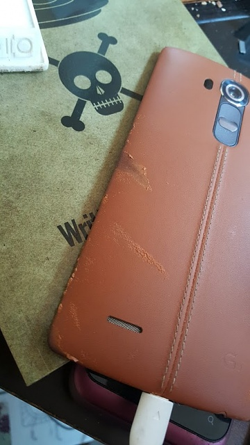 Battle damage on your leather battery cover?-20150705_114411.jpg