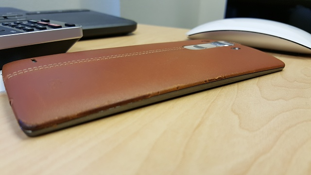 Battle damage on your leather battery cover?-20150706_103832.jpg