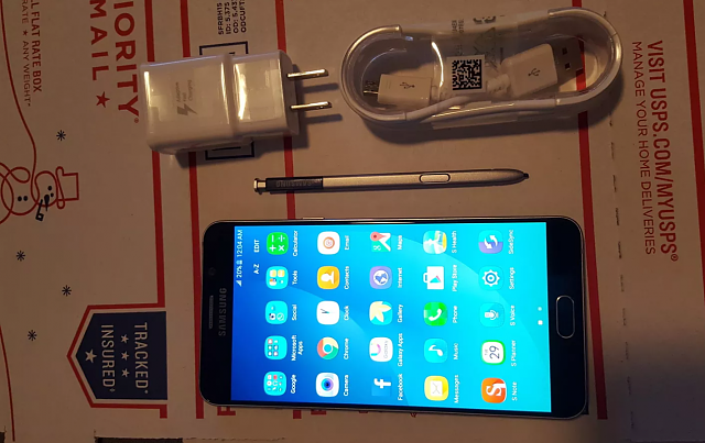 Factory Unlocked 32GB Galaxy Note 5 Model SM-N920G w/ Accessories-note-5-front-use.png