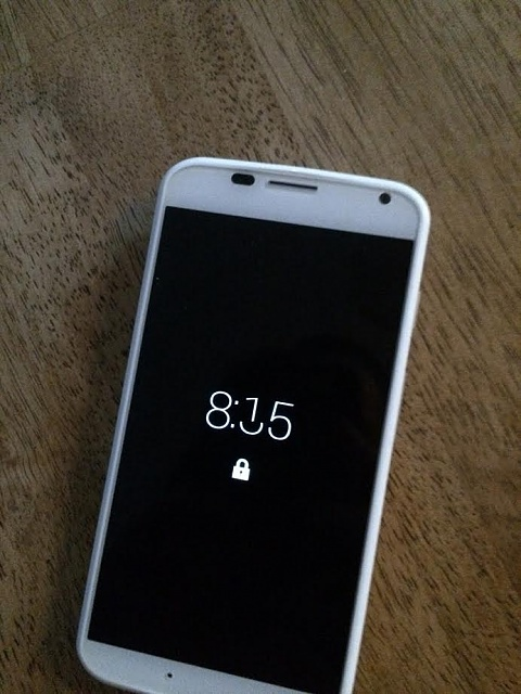 Fix? New Moto X has disjointed time on active display-phone_02.jpg