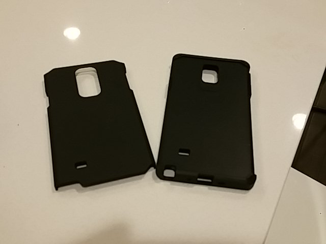 I found a good cheap rugged case that fits all carriers (VZN) and is free of bad branding.-camerazoom-20141122194303622.jpg