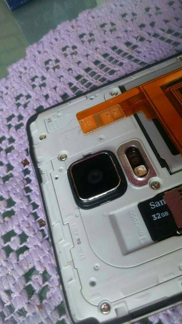 Black Note 4 Owners - Metal Bezel paint chipping?-received_10204443102023259.jpg