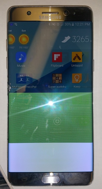 TWO INCH drop onto the edge of my PLASTIC center counsel the screen cracked-phone.jpg