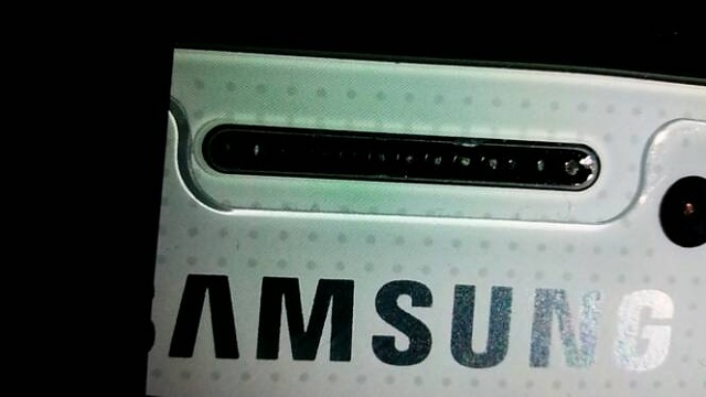 chipped metal above samsung logo. brand new phone-20140731_151838.jpg