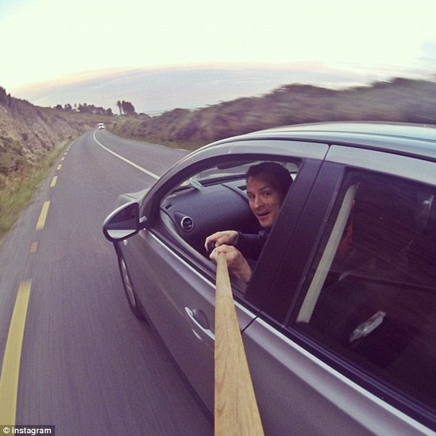 What's your favorite car holder for Samsung Galaxy S6?-1411621494807_wps_41_selfie_on_a_stick_people_.jpg