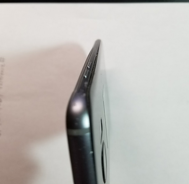 Is your S7 Edge back cover separating possibly from a swelling battery-volume-side.jpg