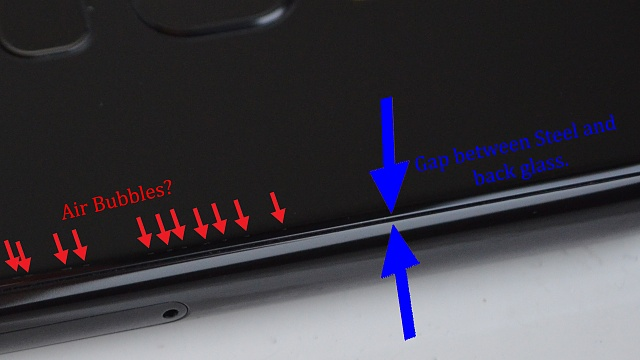 Anyone know whats going on with my back cover? Little airbubbles?-airbubbles1.jpg